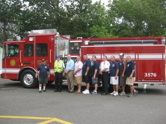 Neptune City Fire Department Group Photo in front of Fire Truck
